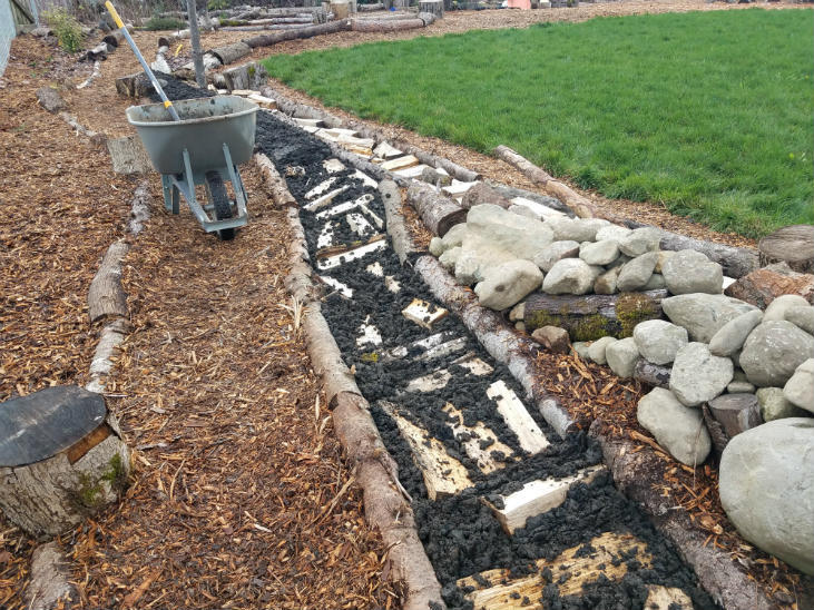 Start a fruit tree guild with rock piles
